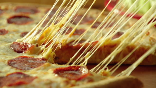 Pizza slice cheese pull