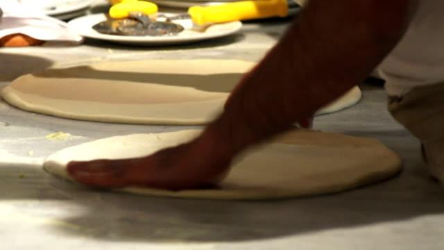 Pizzaiolo Handling Pizza Dough Close-up video