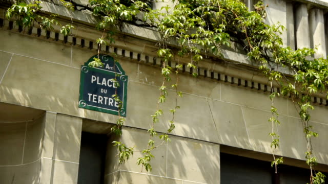 Place du Tetre sign at Montmartre. paris, France A street sign of Place du Tetre at Montmartre in Paris, France. The typical french blue street nameplate hangs at the famous square Montmartre where artists and painters sell their art. The parisian hill draws a lot of visitors and tourists. french architecture stock videos & royalty-free footage