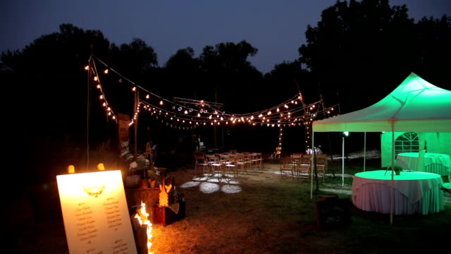 Places for the wedding ceremony illuminated by hundreds of lights. video