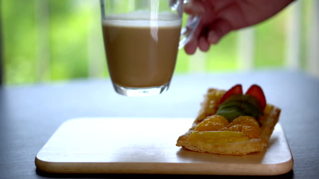 Placing Coffee Cup on Wooden Tray With Pastry in Cafe Close up Food Footage positioning stock videos & royalty-free footage