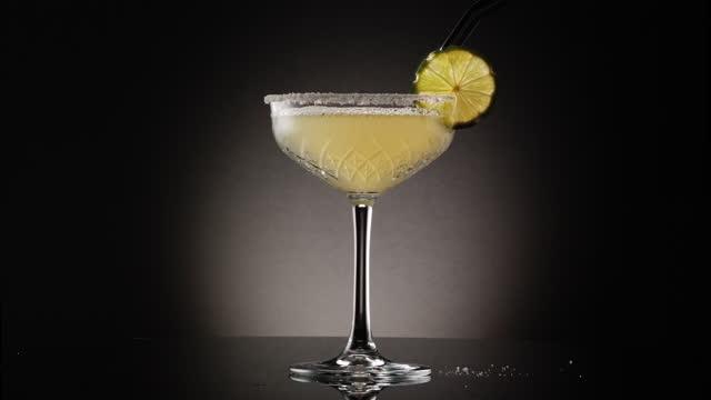 placing garnish on a margarita from a series of Margarita shots margarita stock videos & royalty-free footage