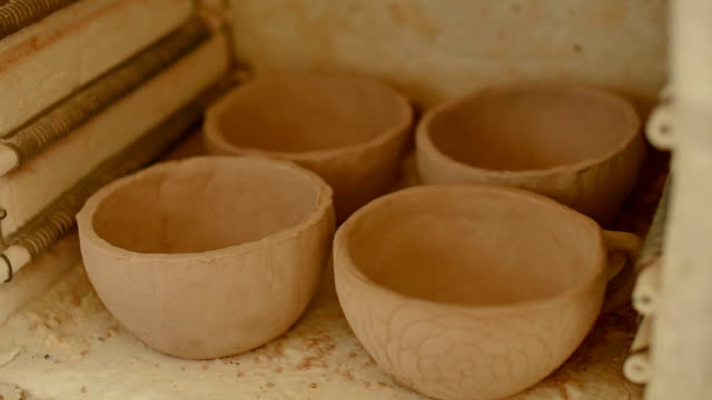 Placing pottery in kiln video