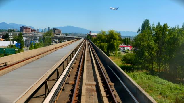Plane Descending, Landing in Vancouver, Skytrain 4K Plane Descending, Landing in Vancouver, Skytrain vancouver canada stock videos & royalty-free footage