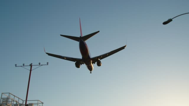 Plane flies over the head, departing into the Los Angeles Airport