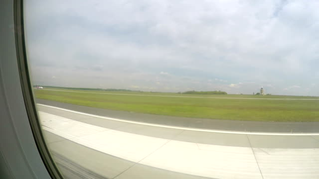 Plane gaining speed on runway before takeoff, flight departure from airport video