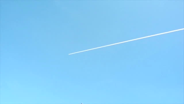 Plane in the sky leaves a trail video