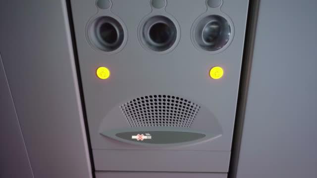 plane interior. Passenger signage over head video