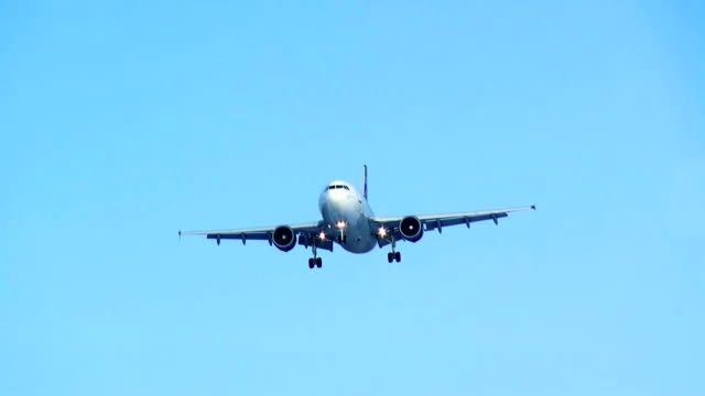 Plane landing. Blue sky. HD. video