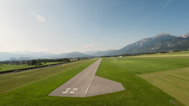 POV Plane landing on the airstrip in sunshine