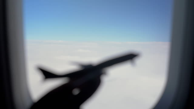 Plane model against clouds and sky in illuminator
