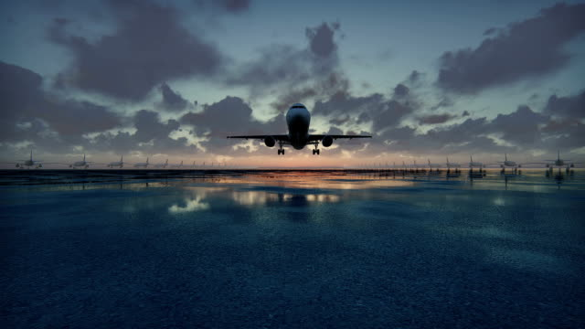 stockvideo's en b-roll-footage met vliegtuig opstijgt bij zonsondergang achtergrond in slow motion - schiphol
