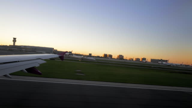 plane taking off at sunset over toronto video