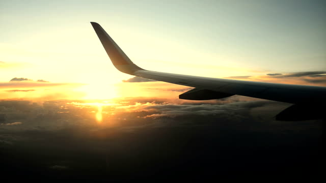plane window sky sunset video