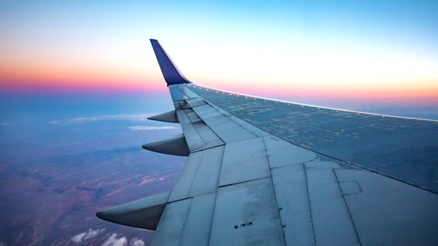 Plane Wing Aerial View During Sunset video