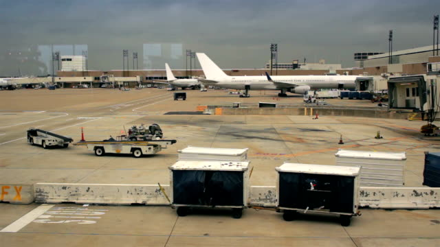 Planes parked at airport gates. video