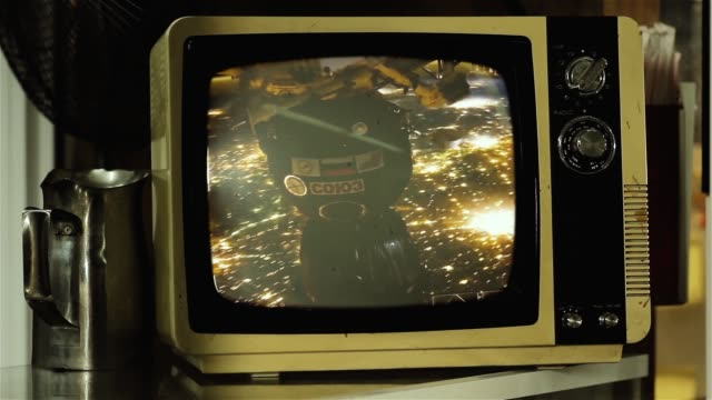 Planet Earth and City Lights from Space on a Retro TV.