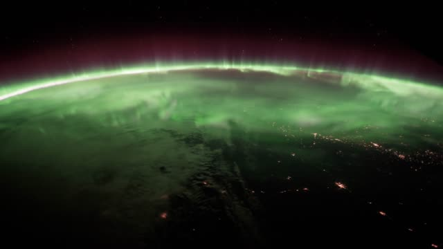 planet earth at night seen from the space. elements of this video furnished by nasa. - бог стоковые видео и кадры b-roll