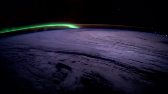 Planet Earth at night seen from the the International Space Station ISS. Elements of this video furnished by NASA video
