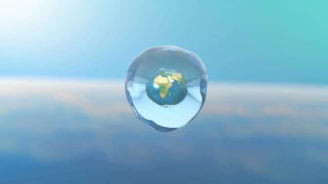 3d planet earth in a drop of water. 4k. ultra hd. - tap water стоковые видео и кадры b-roll