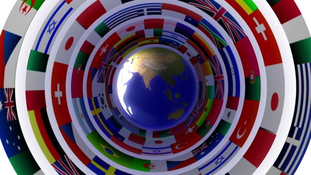 vídeos de stock, filmes e b-roll de planeta terra com bandeira anéis concêntricos - futebol internacional