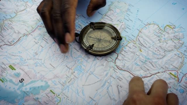 Planning trip with a map and compass