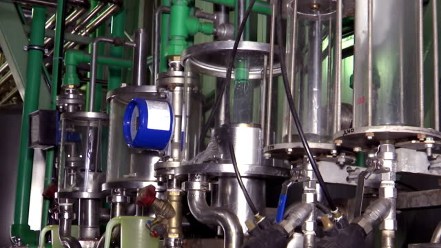 Plant for production of bio-ethanol Apparatus for the production of bio ethanol part of a chemical plant biofuel stock videos & royalty-free footage