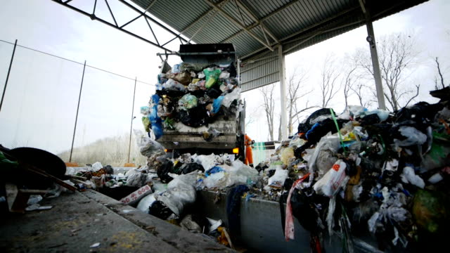 Plant for Sorting and Recycling. The Garbage Truck Unloads Garbage into the Dump video