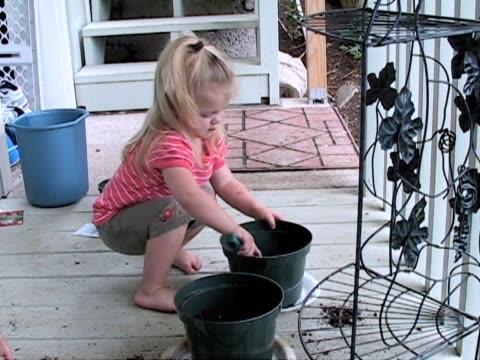 planting seeds 01 - endast flickor bildbanksvideor och videomaterial från bakom kulisserna
