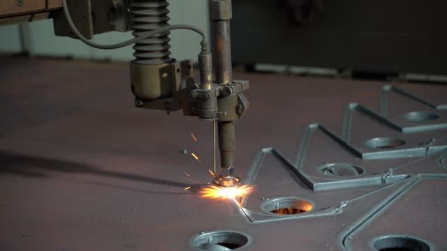 plasma cutting of metal on an automatic laser machine. - metallurgia video stock e b–roll