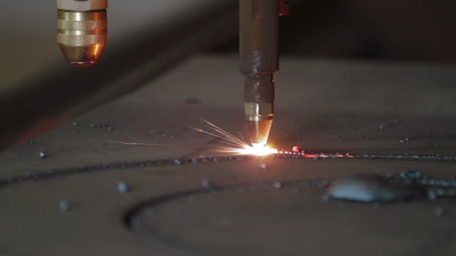 Plasma cutting of metal with a cnc. A plasma cutter cuts a workpiece from a sheet of metal. Laser cutter in production. Industrial metal cutting by plasma laser. video