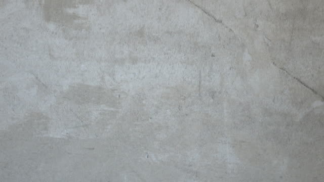gipsu, cementu na ścianie moździerz - ściana filmów i materiałów b-roll