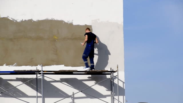 Plasterers Builders plastered wall in a commercial building. Wor video