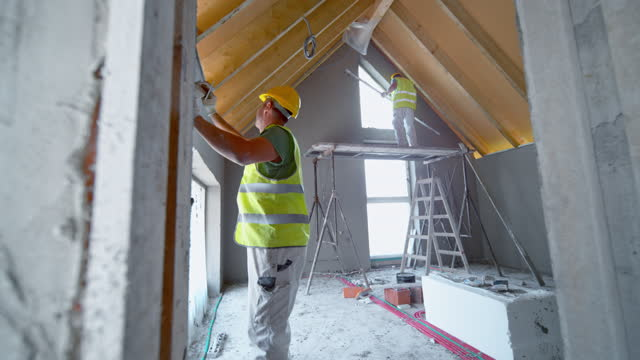 Plasterers working in a building