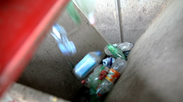 Plastic bottle on conveyor belt for recycling process
