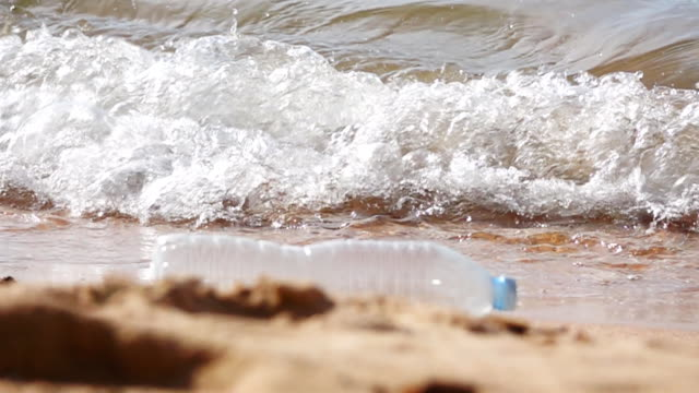 HD SUPER SLOW MO: Plastic bottle On The Beach video