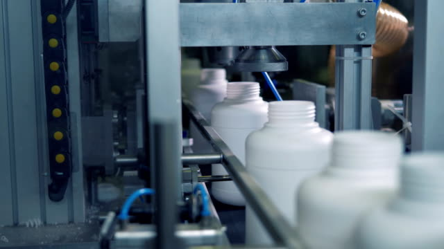 Plastic bottles going through pressing mechanical equipment video
