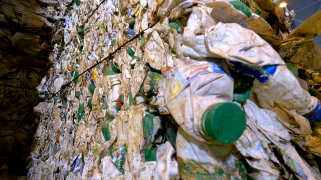 Plastic bottles ready for recycling. Garbage sorting plant. Dolly shot. video