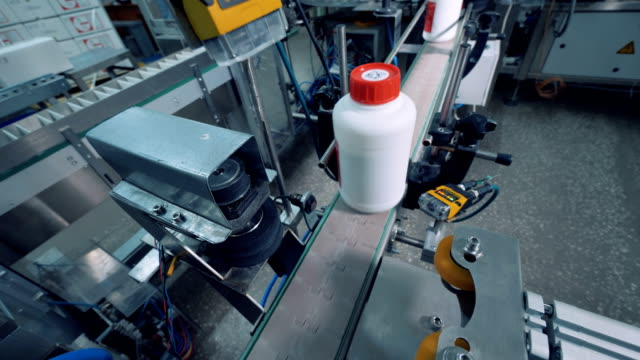 Plastic bottles with chemicals are getting polished by a machine video