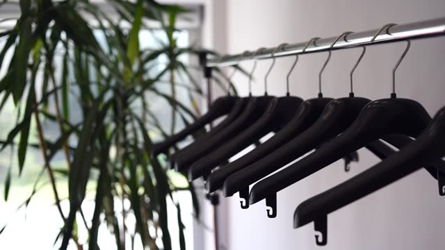 Plastic empty clothes hangers on rack