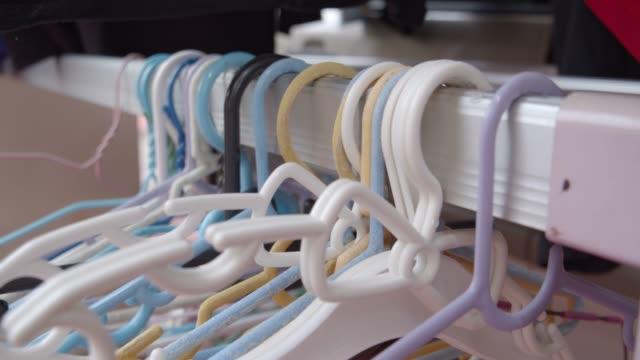 a plastic hangers - space background стоковые видео и кадры b-roll