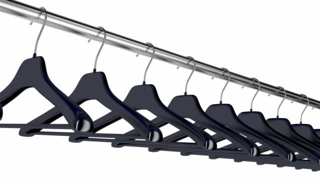 Plastic hangers Plastic hangers hanging on rod coathanger stock videos & royalty-free footage