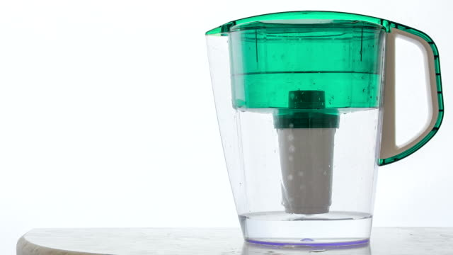 plastic jug for water filtration water filtration process at home purified water stock videos & royalty-free footage