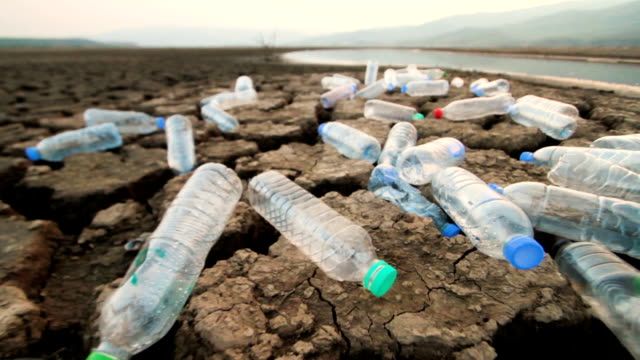 plastic pollution and environment concept. - clima video stock e b–roll