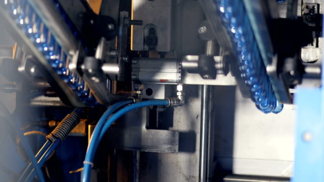 Plastic pre-forms moving on a conveyor at a plant. video