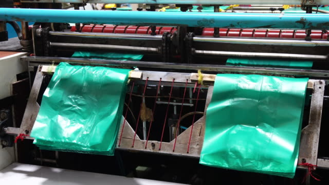 plastic sheet cutting machine - plastic stock videos and b-roll footage