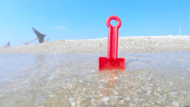 Plastic shovel on the beach