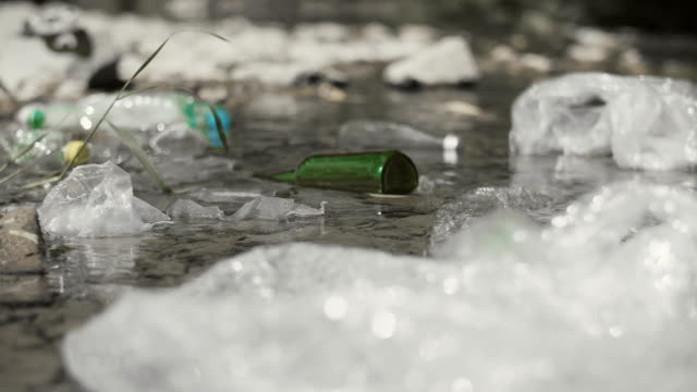 plastic waste in the river - earth day stock videos & royalty-free footage