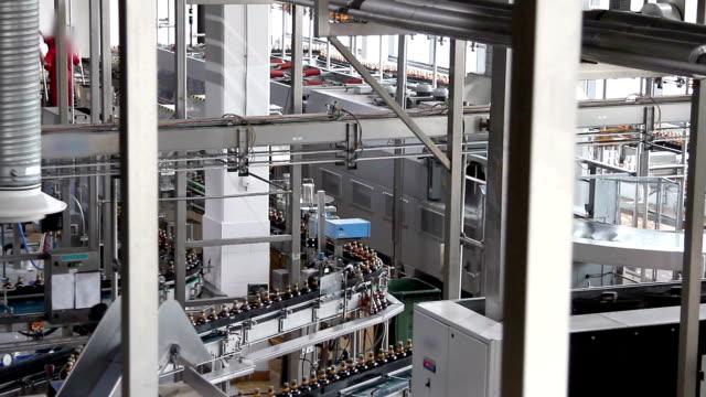 Plastic water bottles on conveyor or water bottling machine video