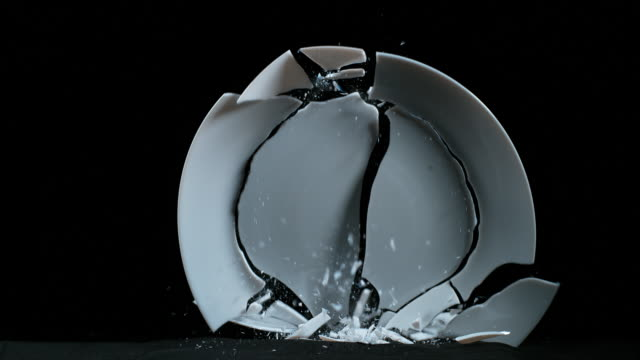 Plate falling and exploding on Black Background, Slow Motion 4K Plate falling and exploding on Black Background, Slow Motion 4K breaking stock videos & royalty-free footage
